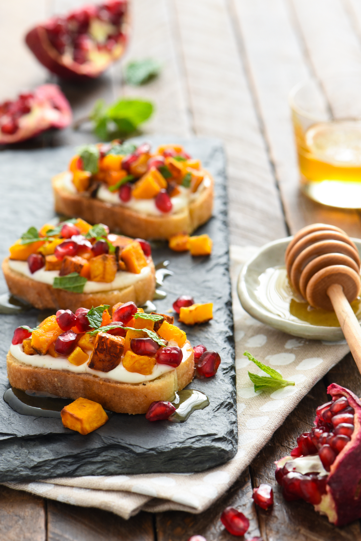 butternut-squash-pomegranate-crostini-with-whipped-feta-and-honey